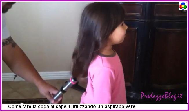 fare la coda ai capelli con aspirapolvere