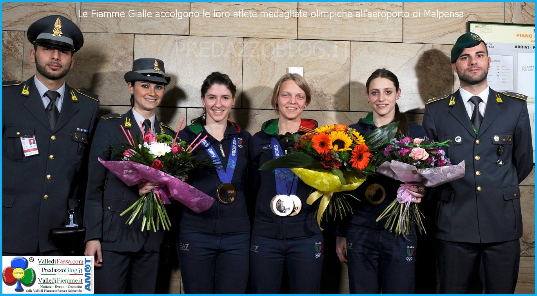 fiamme gialle medaglie olimpiche sochi Le Fiamme Gialle accolgono le loro atlete medagliate olimpiche all'aeroporto di Malpensa